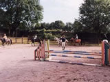 Horses & riders in the jumping ring